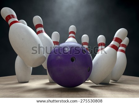 An arrangement of white and red used vintage bowling pins being struck by a bowling ball on a wooden bowling alley surface on a dark background - stock photo