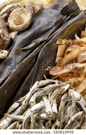 An array of different dried foods in a basket. - stock photo
