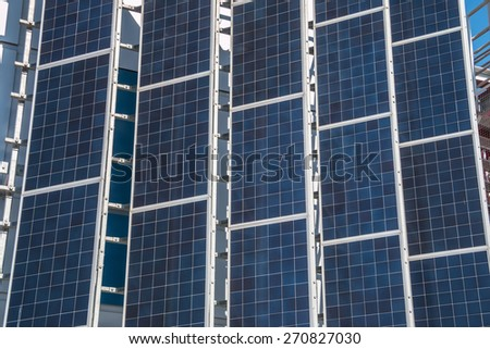 An array of modern solar panels - stock photo