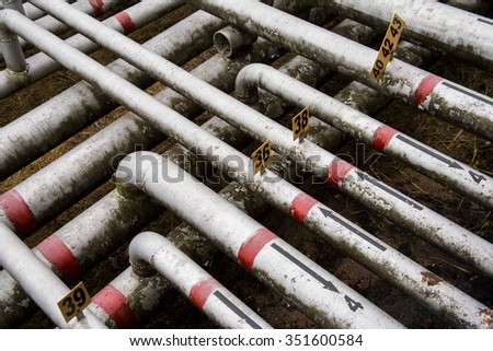 an array of old pipes with arrows - stock photo