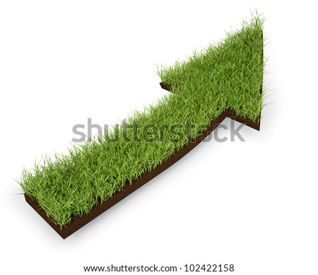 An arrow made out of a patch of grass - stock photo