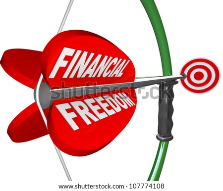 An arrow reading Financial Freedom is aimed with a bow at a bulls-eye targeting wealth, independence in finances, economic security and comfortable retirement - stock photo