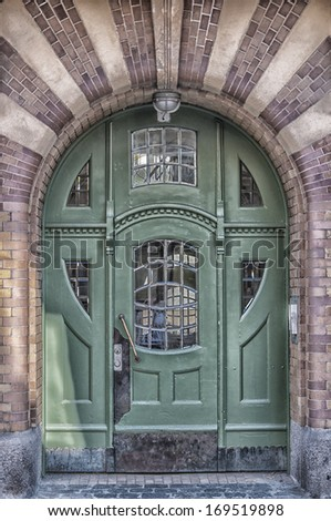An art deco style entrance painted green situated in the Swedish town of Ystad. - stock photo