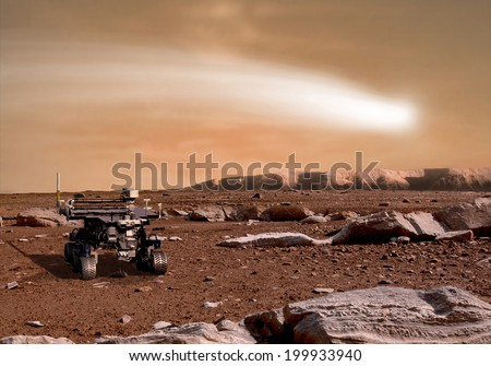 An artist's depiction of the close pass of comet C/2013 A1 over the Martian landscape.  It is scheduled to pass by Mars in October of 2014. Rover image courtesy of NASA. - stock photo