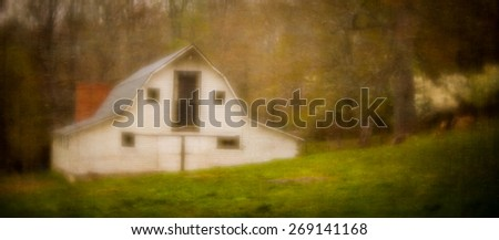 An artistic, soft focus image of a country barn during the spring with added texture to create a piece of art. - stock photo