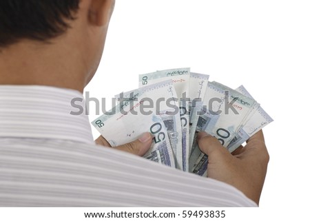 An Asian man counting some cash