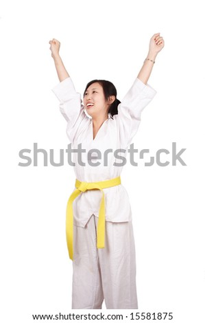 An asian raising her arms after wining taekwondo game. - stock photo