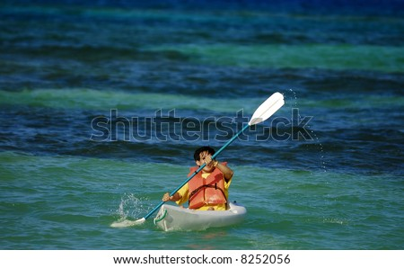 an asian sportsman having fun with his kayak