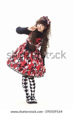 An Asian woman wearing a dress demonstrating Lolita Fashion, a sub-genre of kawaii culture. - stock photo