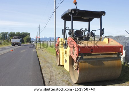 An asphalt paver used to flatten freshly poured asphalt/Asphalt Paver/A Paver used for roadwork construction.