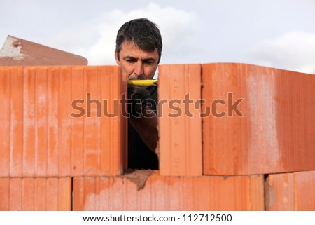 An assiduous bricklayer - stock photo