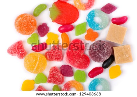 An assortment of colorful candy on background with jellybeans, gumdrops and other jelly candies - stock photo
