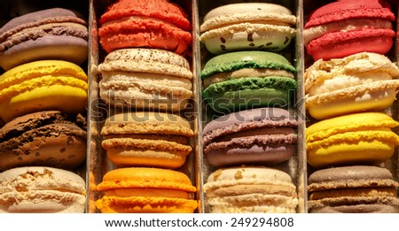An assortment of colourful Frence macaroons arranged as in a gift box - stock photo