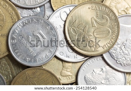 An assortment of Greek drachma coins from the 1990s - stock photo
