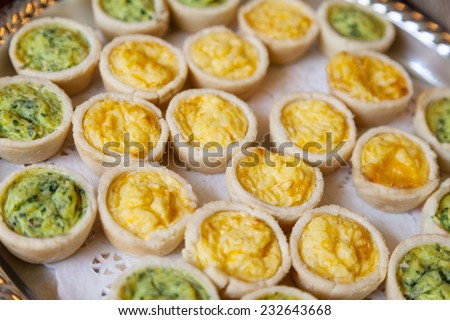An assortment of mini quiche - stock photo