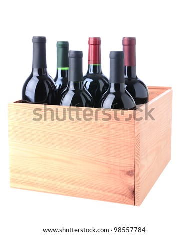 An assortment of Red Wine bottles standing in a wooden crate isolated on a white background. - stock photo