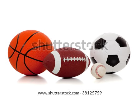 An assortment of sports balls including basketball, american football, soccer ball and baseball on a white background