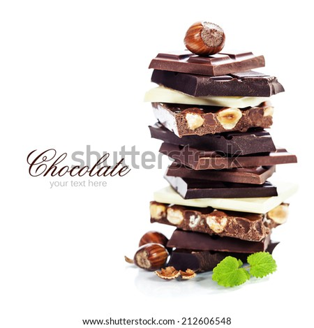 An assortment of  white, dark, and milk chocolate with nuts - on white bckground - stock photo