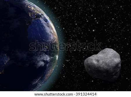 An asteroid flies around the planet earth on a background of stars. - stock photo