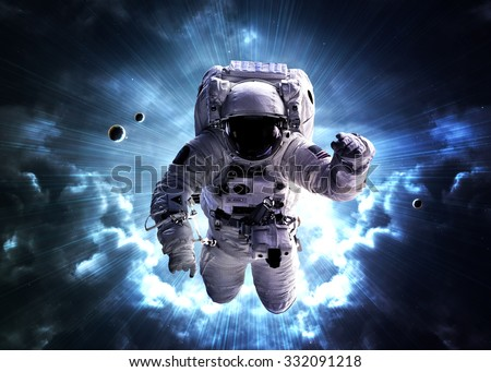 An astronaut floats above billions of stars. Stars provide the background. Elements of this Image Furnished by NASA. - stock photo