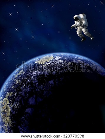 An astronaut floats in space over a planet. - stock photo