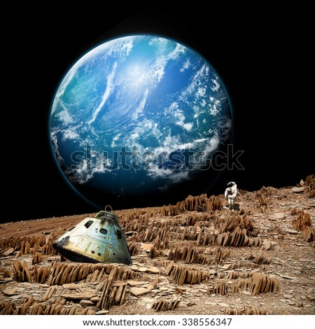 An astronaut surveys his situation after being marooned on a barren and rocky moon. An alien, and water covered planet,  shines in the background. - Elements of this image furnished by NASA.