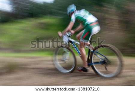 An athlete on a bicycling race competition, Motion blur. - stock photo