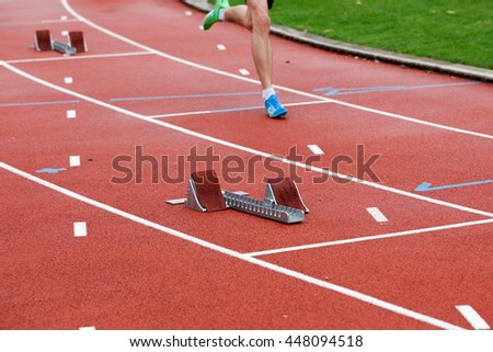 An athlete that passes current to a starting block