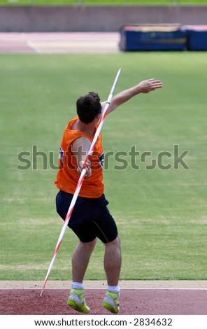 An athlete throwing a javelin in a sporting event - stock photo
