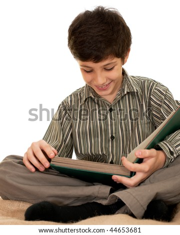 An attentive boy is reading a book