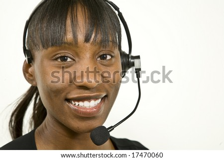 An attractive African American customer support representative, office worker or business woman - stock photo