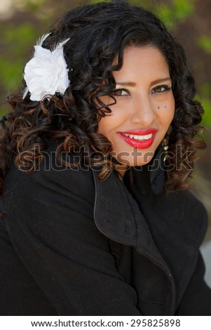An attractive and fashanable young hispanic woman - stock photo