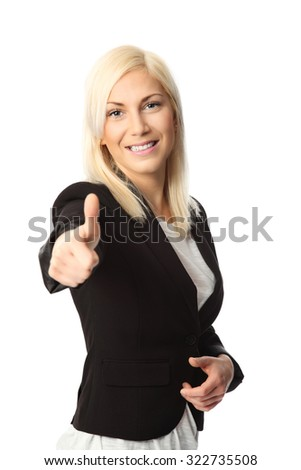 An attractive blonde businesswoman in a black suit standing against a white background.  - stock photo