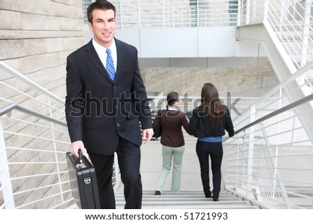 An attractive  business man walking up stairs at office building