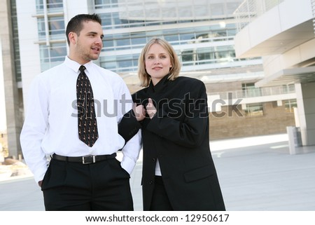 An attractive business team at their office building