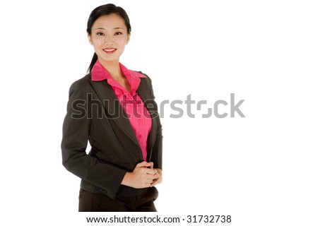 An attractive businesswoman posing in a studio