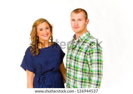 An attractive couple against a white background in the studio to create this isolated portrait.