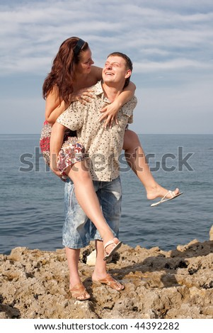 An attractive couple playing around on the beach