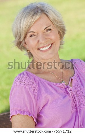 An attractive elegant smiling senior woman - stock photo