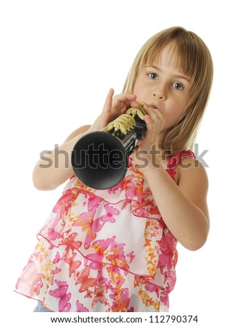 An attractive elementary girl playing a plastic clarinet.  On a white background.