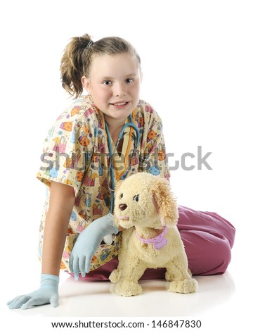 "An attractive elementary ""veterinarian"" posing with her toy pup.  On a white background."