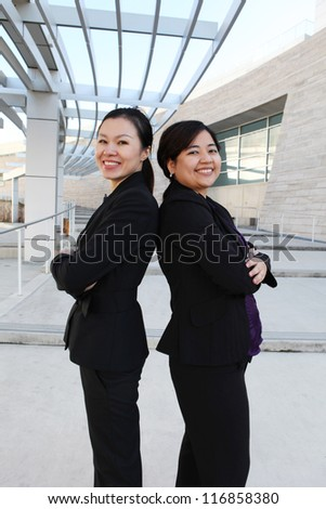 An attractive ethnic business women team at office building - stock photo
