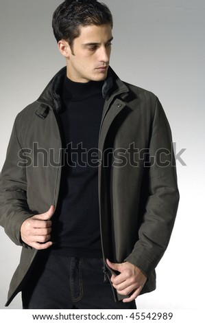 An attractive fashion man shot in studio - stock photo