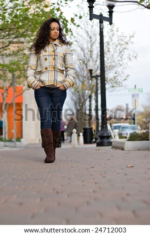 An attractive girl out walking in the city. - stock photo