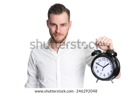 An attractive man wearing a white shirt holding a big clock, standing against a white background. - stock photo