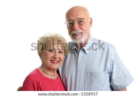 An attractive senior couple against a white background. Horizontal view. - stock photo