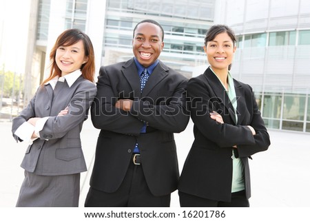An attractive team of diverse business people at company office building - stock photo