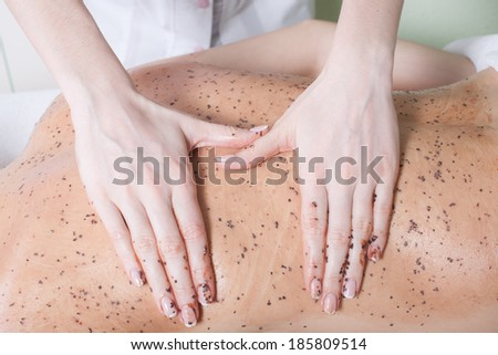 an attractive woman getting a chocolate massage at spa - stock photo