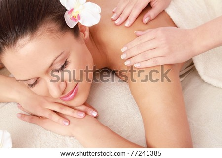 An attractive woman getting spa treatment