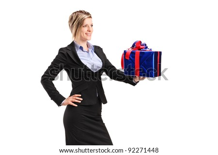 An attractive woman holding a gift isolated on white background - stock photo